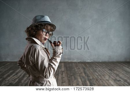 Little boy with a smoking pipe