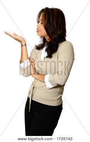 Asian Businesswoman In Presenting Gesture.