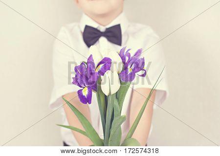 Bouquet Of Spring Flowers In Children's Hands