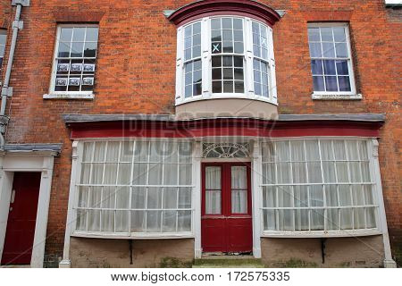 WINCHESTER, UK - FEBRUARY 5, 2017:  Exterior facade of a house on Kingsgate Street with a colorful brick wall and large windows