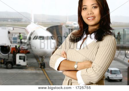 Asian Businesswoman With Aircraft In Background