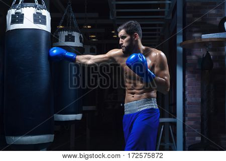 Active man in boxing glowes
