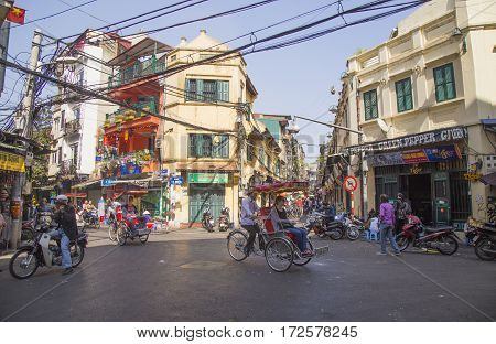 Hanoi, Vietnam - Feb 18, 2017: Wide view of 'international cross' Ta Hien beer corner street of Hanoi 36 old quarter streets. This is a famous street famous with Bia Hoi and delicious street foods.