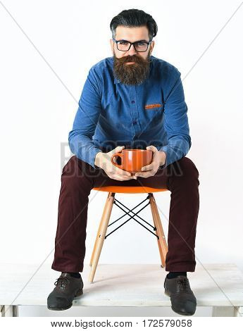 Bearded Man, Brutal Caucasian Hipster With Moustache Holding Orange Mug