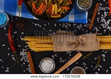 Bunch Of Spaghetti In Sackcloth And Fusilli In Bowl