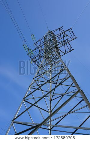 Support  power line against the blue sky. Bottom view