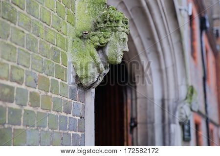 WINCHESTER, UK - FEBRUARY 5, 2017:  Detail of the statue of a bishop at the entrance of St John's Winchester Charity Almshouses