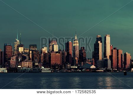 Midtown Manhattan skyline at dusk panorama over Hudson River