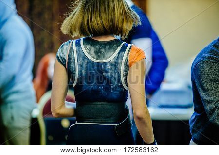 young girl powerlifter on back talc competitions in powerlifting