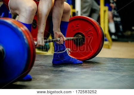 feet male athlete powerlifter deadlift barbell powerlifting