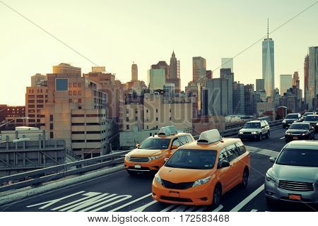 Rush hour traffic at sunset in downtown Manhattan in New York City