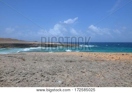 Daimari beach with waves rolling ashore in Aruba.