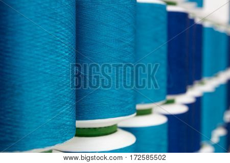 Closed up of vairous blue color thread reel background
