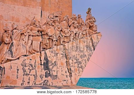 Stone ship shaped Monument to the Discoveries hailing Portugals famous navigator and history, Portugal at sunset