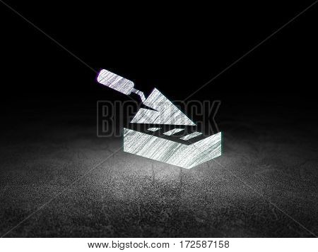 Building construction concept: Glowing Brick Wall icon in grunge dark room with Dirty Floor, black background