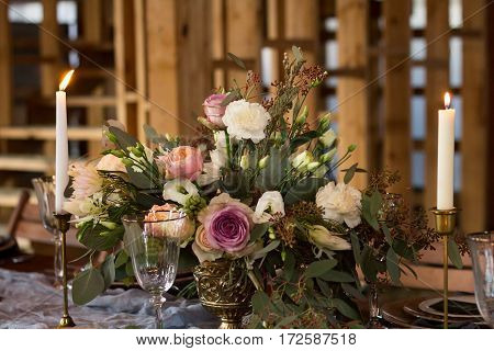 Decoration wedding table before a banquet. Bouquet and candles. Vintage Style. Wedding party.