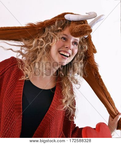Happy blonde woman wearing mammoth cap portrait.