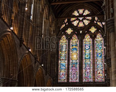 GLASGOW, SCOTLAND - 29 JAN 2017: Stain glass windows in the interior of the gothic Glasgow cathedral, one of the few that withstood the Reformation. Today it is a gtahering of the Church of Scotland