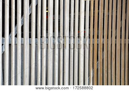Close-up of pattern and texture and verticle planks of slatted wooden gate barrier