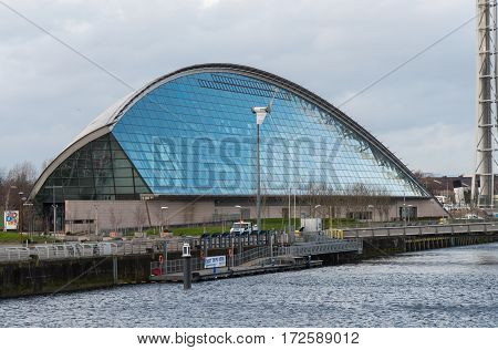 GLASGOW, SCOTLAND - 31 JAN 2017: View of Glasgow Science Centre and IMAX Theatre from the River Clyde. The centre opened in 2001 and is now a major visitor attraction