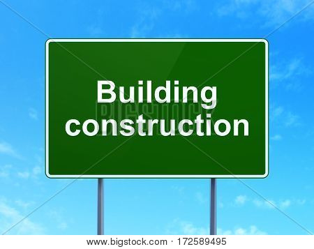 Constructing concept: Building Construction on green road highway sign, clear blue sky background, 3D rendering
