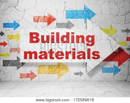 Building construction concept:  arrow with Building Materials on grunge textured concrete wall background, 3D rendering