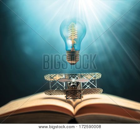 antique edison style filament light bulbs and aircraft figther on open book with abstract light studious student education concept.