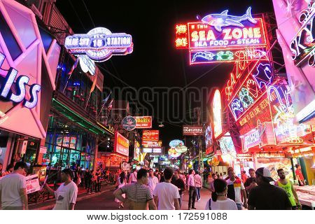 Walking Street in Pattaya at night PATTAYA, THAILAND - DECEMBER 23, 2016: The street is a tourist attraction that draws foreigners and Thai nationals, The Walking Street area includes seafood restaurants, beer bars, nightclubs and hotels.