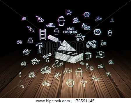 Building construction concept: Glowing Brick Wall icon in grunge dark room with Wooden Floor, black background with  Hand Drawn Construction Icons