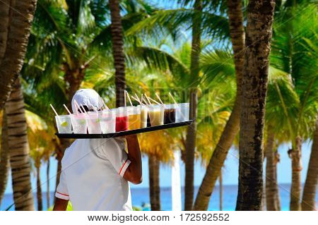 Playa del Carmen Mexico - January 28 2017: Large tray of drinks being delivered in caribbean holiday resort