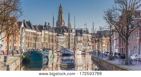 GRONINGEN, NETHERLANDS - FEBRUARY 15, 2017: Panorama of a cruiseboat in a canal in Groningen, The Netherlands