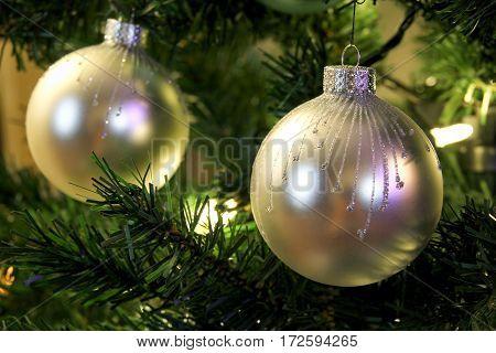 christmas ball on christmas tree closeup with selective focus