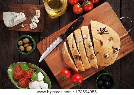 Italian focaccia bread similar to pizza with garlic nad rosemary
