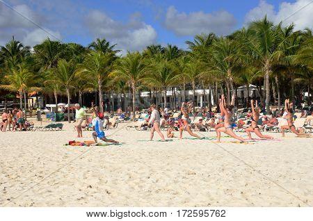 Playa del Carmen Mexico - January 28 2017: Keep fit class on caribbean beach