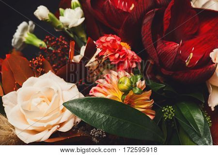 Beautiful bouquet closeup, composition of rose flowers and leaves. Florist art background