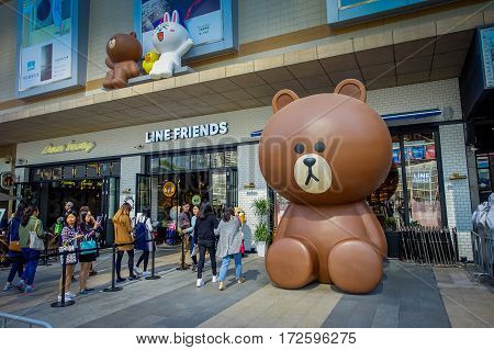 SHENZEN, CHINA - 29 JANUARY, 2017: Entrance to pastry shop with beautiful display of cakes and cookies in animal shapes.