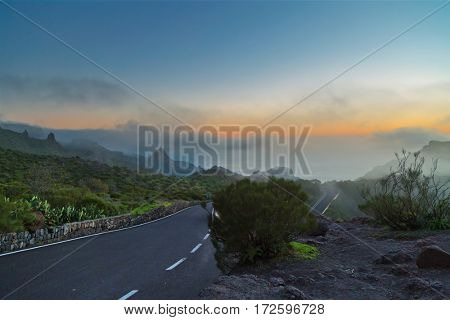 Stunning views of the sunset over the mountains road in the clouds. Tenerife, Canary Islands. Spain