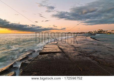 Stones at topical beach at beautiful sunset.Costa Adeje, Tenerife, Spain