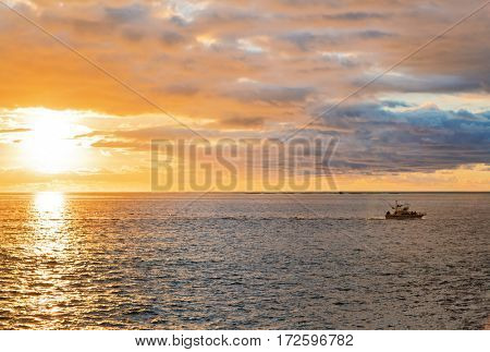 Landscape with boat at sea in sunset time  in Tenerife, Canary Islands, Spain