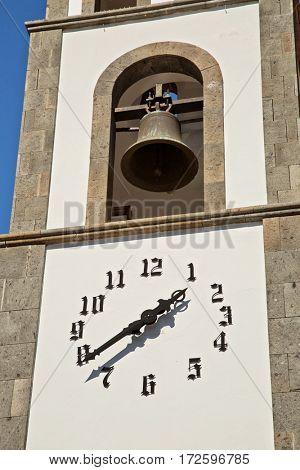 A church with clock and bell in Santiago de Teide. Tenerife island, Spain
