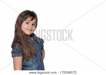 Portrait in half of the body of long haired brunette little girl isolated on the white background. Girl is standing sideways and is looking at the camera.