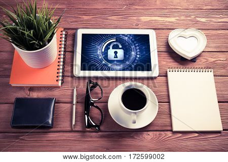 Business workplace with office stuff and tablet with padlock icons on screen