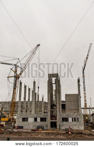 concrete construction yard of building view on crane cloudy sky background