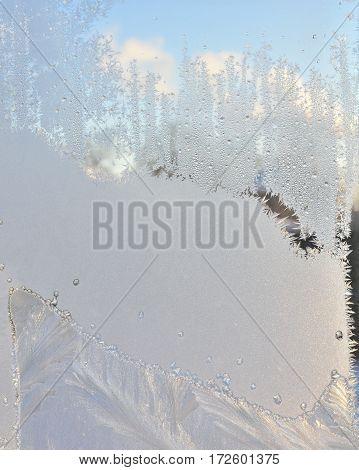 Frosty pattern on winter window, cold winter