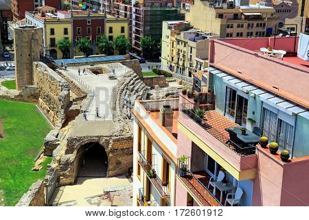 TARRAGONA/ SPAIN - MAY 16. The Roman circus and the Tower of nuns of the 14th century surrounded by typical spanish residential houses on May 16, 2015. Tarragona, Spain.