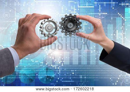 Businessman in teamwork concept with cogwheels