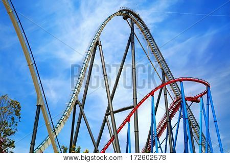 PORT AVENTURA/ SPAIN - MAY 11. Attractions Shambhala and Dragon Khan in the theme park Port Aventura on May 11, 2015 in city Salou, Catalonia, Spain.