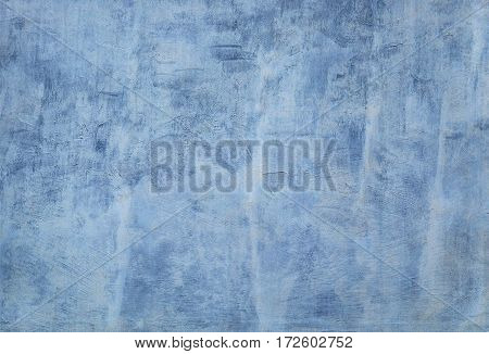 Poor whitewashed dirty blue concrete wall for background and texture.