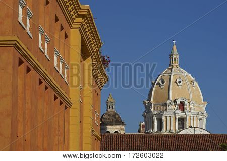 Dome of the historic Iglesia de San Pedro Claver rising above the rooftops of the Spanish colonial city of Cartagena in Colombia.