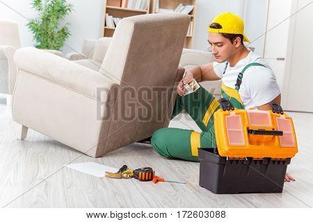 Worker repairing furniture at home